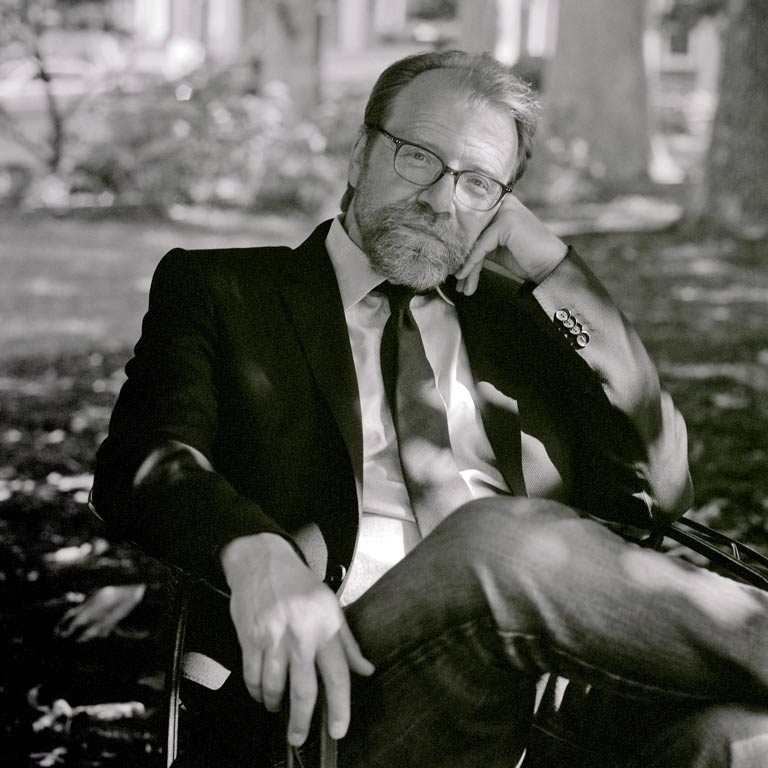 George Saunders sitting on a park bench