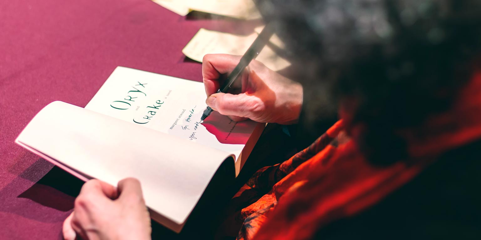 author Margaret Atwood signs her book